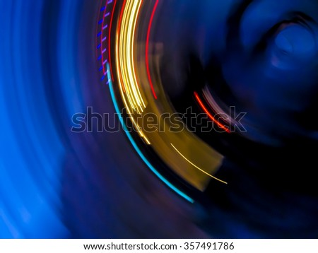 Abstract light trails, dark blue background with red and yellow circle  - stock photo