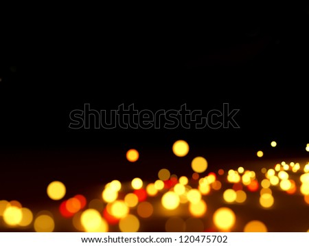 Abstract lights on black background - stock photo