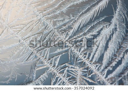 abstract macro of frost  ice crystals on glass for background or texture - stock photo