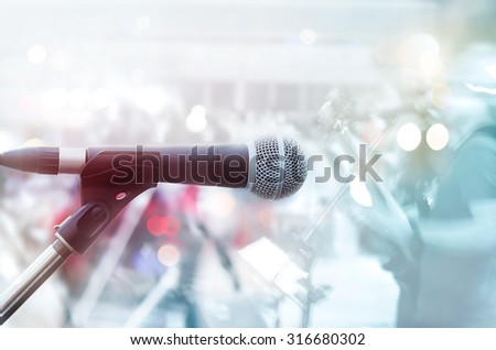 Abstract microphone with guitarist on stage, pastel color and soft concept - stock photo
