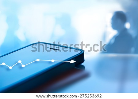 Abstract mobile phone and graph chart growth on screen and business man background, blue tone style - stock photo