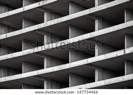 Abstract modern architecture background with exterior of concrete floors and walls under construction - stock photo