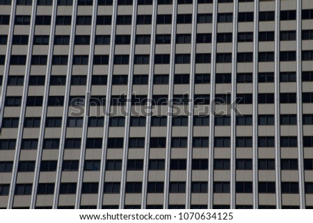 Abstract modern buildings windows and reflections. Skyscraper building and architecture. Background image with strong lines and rectangular shapes.