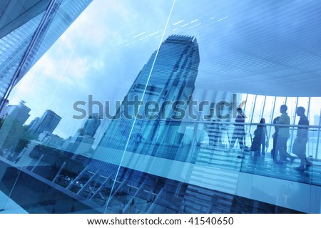 Abstract modern city background with people walking over buildings reflections. - stock photo