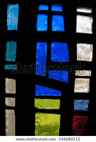 Abstract modern stained glass window made of chipped slab glass, located in Saint Benedict's Monastery, Winnipeg, Manitoba, Canada, designed by the late Gabriel Loire of Chartres, France - stock photo