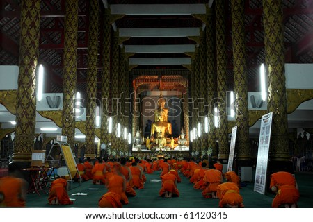 Abstract Monk pray in building temple , Chiangmai Thailand - stock photo