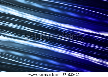 Abstract motion blur of blue night light on a black background.