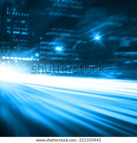 Abstract motion blurred image of traffic in the city at night. - stock photo