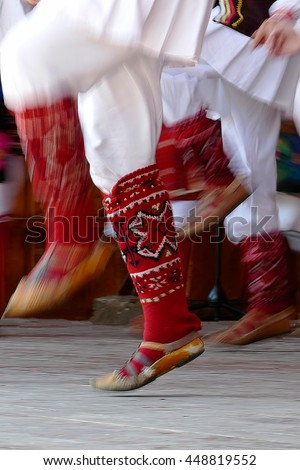 Abstract motion feet of dancers with traditional bulgarian folk dances. - stock photo