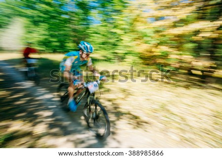 Abstract motions blur background - mountain Bike cyclist riding track at sunny day, healthy lifestyle active athlete doing sport. - stock photo