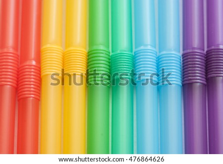 Abstract multicolored background. Background of drink straws.
