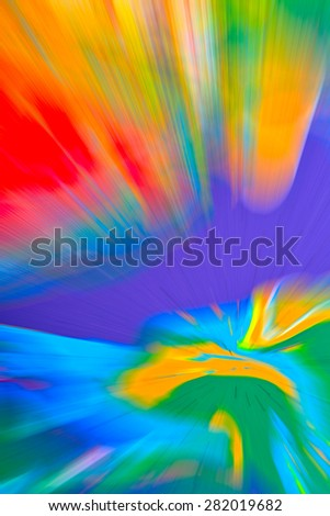 Abstract multicolored background. Colorful radial blur, streaks of light, sunburst or starburst. Rays of versicolor light. Digitally generated image. Acrylic painting with a zoom effect. - stock photo
