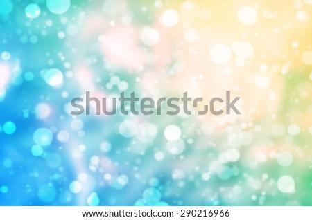 Abstract Natural Glittering Snowflake Color Pastel Yellow and Blue Bokeh Texture Background - stock photo
