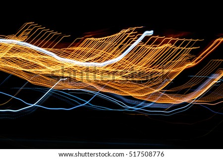 Abstract night lights lines motion background,Abstract blur messy light trail.