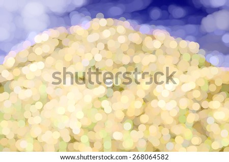 Abstract of a desert hill like a heap of pearls, or a landfill of glowing lights, under blue and white sky - stock photo