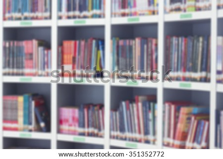 Abstract of blur books on shelves in library