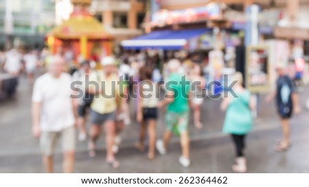 Abstract of blurred people walking in the market