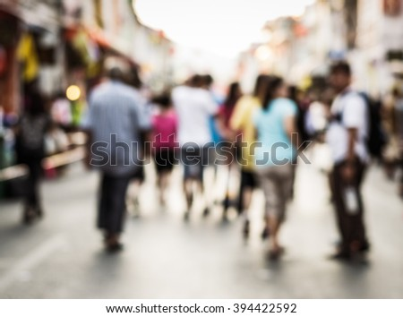 Abstract of blurred people walking on the street of phuket old town