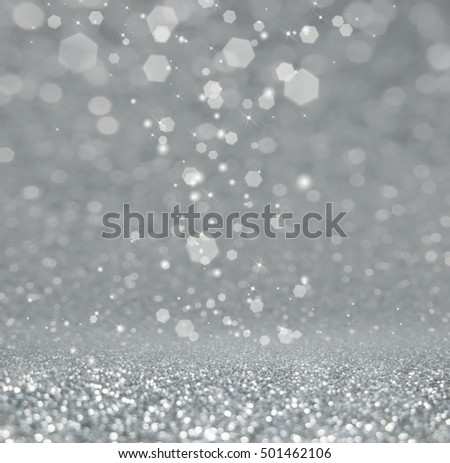 Abstract of Bright and sparkling bokeh background. Silver bokeh-blurred lighting from glitter texture. Luxury design background.