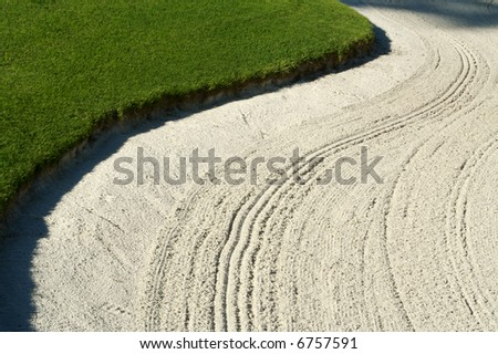 Abstract of bunker and putting green. - stock photo