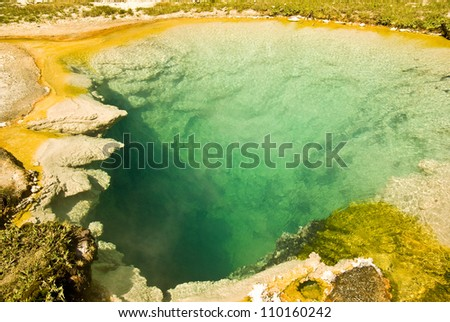 Abstract of colorful  patterns formed by geothermal pool in Yellowstone National Park, Wyoming - stock photo