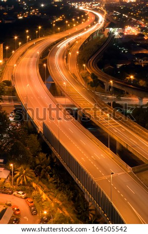 Abstract of light trail at the busy highway at night - stock photo