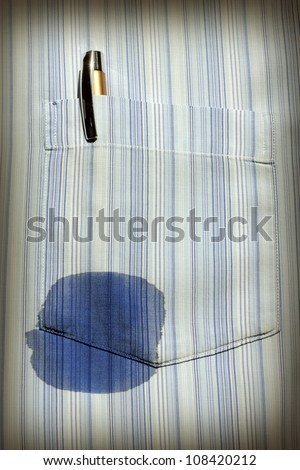 abstract of old technology with spot on the shirt with pen - stock photo