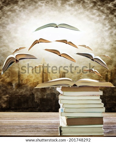 abstract of open book on stack and flying book to the light over urban scene use for idea ,creative and education topic - stock photo
