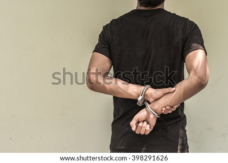 abstract of the man was bound by hand in the shackle of black man out of freedom and leave space for adding your content. background look old or vintage style. (vintage color tone) - stock photo