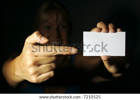 Abstract of Woman Holding Blank Business Card. Room for text and your own message. - stock photo