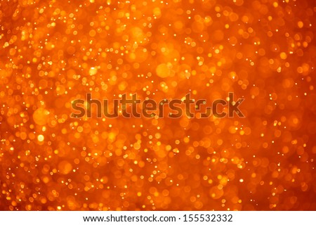 abstract orange background with particles - stock photo
