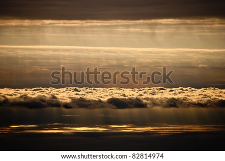 Abstract orange sky with sun rays over the sea
