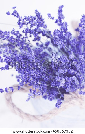 Abstract overhead view of a basket of lavender flowers. - stock photo