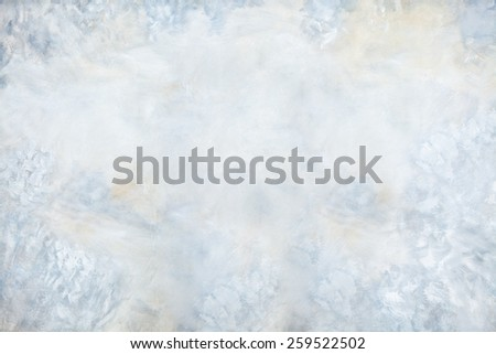 Abstract painted background in subtle shades of blue, gray, and peach.
