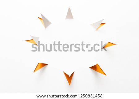 abstract paper cut with triangles around a main circle to form the sun shape on white - stock photo