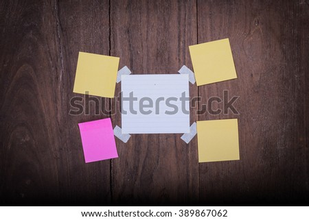 Abstract paper note sticky note Tape  Paper on wood . Background wood with blank notes. sticker note - stock photo