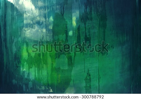 abstract pattern in green and blue taken on a plastic tarpaulin in closeup
