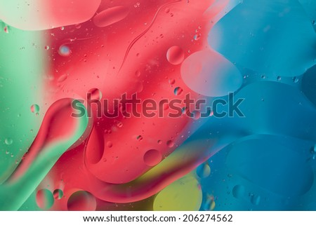 Abstract pattern of colored oil bubbles on water - stock photo