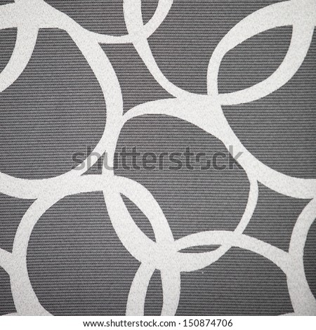 Abstract pattern of interlocking irregular white circles on a grey lived background - stock photo