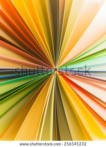 abstract pattern with colorful paper arranged in circle - stock photo