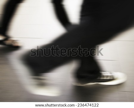 Abstract people are running in the city. Motion blur. - stock photo