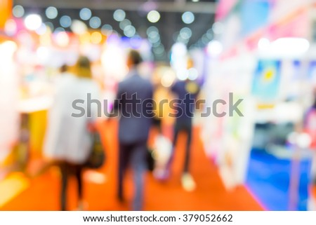 Abstract people walking in exhibition blurred background - stock photo