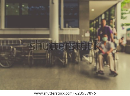 Abstract photo blurred of hospital with patient bed between walk way background, Hospital and physician concept