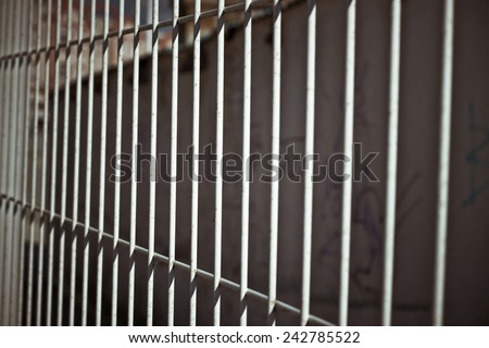 Abstract photo of Iron bars fence. - stock photo