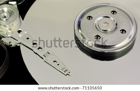 Abstract photograph of the plate and needle of a hard drive.