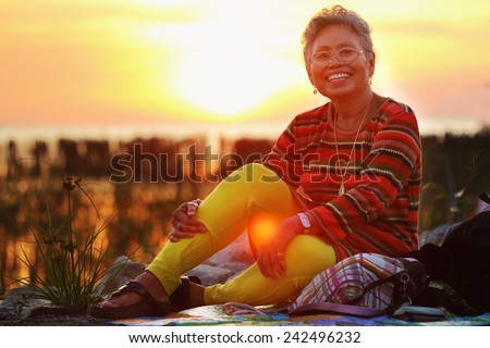 Abstract picture, Asian senior wearing glasses in natural light. - stock photo