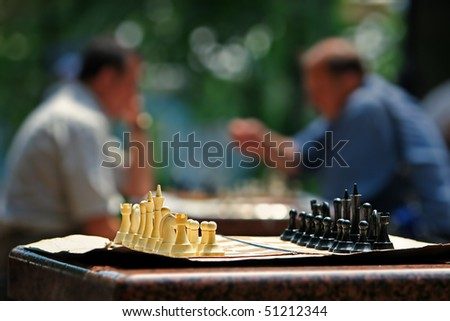 abstract picture with people playing chess - stock photo
