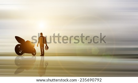 abstract piece of art. biker and motorcycle with background in motion blur - stock photo