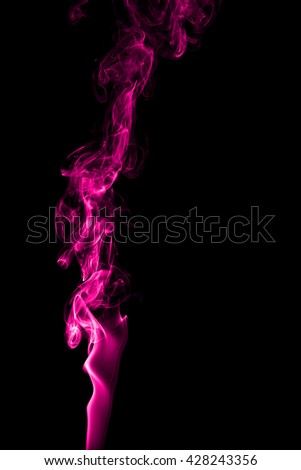 Abstract pink smoke on black background from the incense sticks