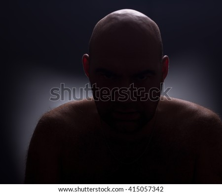 Abstract portrait. Close up silhouette of worrying bald man. - stock photo